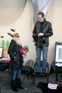 Gracie hovers near Randy at the dog run Halloween Party in 2011