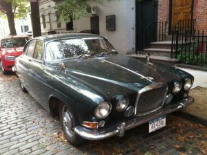 The green Jaguar. Check out the mirrors.