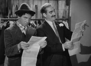 "Grouch Marx and Chico Marx discuss the ""Sanity Clause"" in A Night at the Opera."