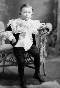 I'm not a goody two shoes. Boy in Little Lord Fauntleroy suit.