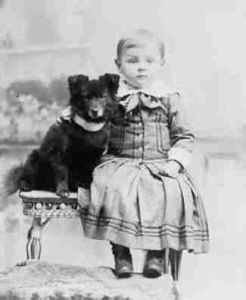 A boy and his dog, circa 1900. The dog does look a little like Gracie.