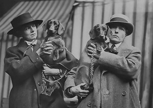 Una Troubridge and Radclyffe Hall and two Dachsunds.