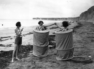 vintage-women-changing-on-beach