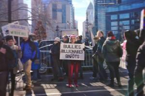 Donna protesting outside Trump's hotel.